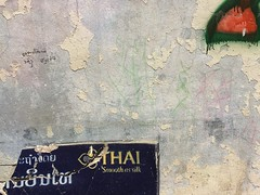 Thai silk (niksin) Tags: wall composition decay graffity thai laos vientiane thaiair smoothassilk benck