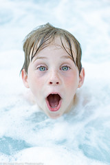 Kid In Bubbles (Michael Muntz Photography) Tags: boy portrait cute water face swim outdoors kid soap expression blueeyes bubbles greeneyes hottub surprise