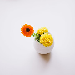 Flowers (krkojzla) Tags: flowers stilllife orange white flower yellow analog vintage square table 50mm flora decoration minimal retro squareformat flowerpot canon5d highkey minimalism f18 minimalistic minimalist ebcfujinon55mmf18