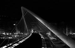(cherco) Tags: street city bridge light shadow blackandwhite man blancoynegro luz silhouette night composition canon puente noche alone ciudad sombra bilbao calatrava lonely solitary nocturne solitario bilbo misterio composicion aloner