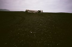DC3_35mmFilm (Purple Cow Pictures) Tags: dc3 plane 1973 iceland wreck wreckage beach us cool old stranded crashed photography landscape desolate landscapephotography 35mm film print oldschool fuji fujifilm minoltaxd5