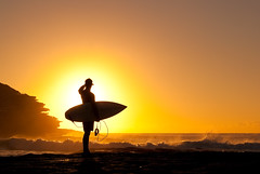 Tamarama Surfer (Kokkai Ng) Tags: ocean sea orange cliff man beach water silhouette yellow rock sunrise person dawn day waves looking surfer sydney australian rocky australia icon surfing dude clear nsw surfboard newsouthwales cloudless tamarama shielding lpseaside