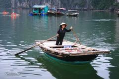 Dark bay (Caroline Neumannova) Tags: blue summer sky sun lake nature water colors beauty architecture canon bay boat women asia vietnamese forbidden asie halong halongbay reflextion pagode 400d