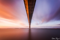 Pont de Normandie - 1 (Matthieu Pegard) Tags: bridge sunset sky bw orange france sunshine seine canon pose soleil long exposure mark 110 bleu ciel filter ii pont 5d normandie honfleur f4 1740 lightroom couch longue nd1000