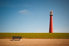 It's so quiet (Janneman-D90) Tags: blue lighthouse bench nederland thenetherlands le dijk vuurtoren dike bankje huisduinen langejaap flickraward