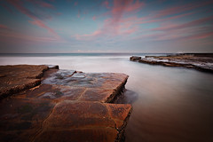 Flat (Xenedis) Tags: ocean pink seascape water clouds rocks dusk pastel australia nsw newsouthwales turimetta