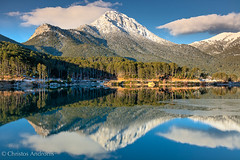 Mountain reflection (Christos Andronis) Tags: blue winter lake green nature colors season landscape europe colours greece peloponnese peloponnesos beautyinnature feneos peloponnesus  lakedoxa greeknature ziriahelmos
