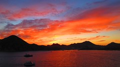 Cabo Sunset (Xynalia) Tags: ocean cruise red reflection water mexico boats disney cabosanlucas