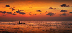 Paddle boarding in Belize (jamiegaquinn) Tags: sunset orange clouds belize board paddle tropics centralamerica cayecaulker