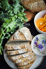 Breakfast with homemade bread (TailorTang) Tags: stilllife food breakfast bread 50mm homemade citrus borage kale sunflowerseed 5014 foodphotography violas edibleflower flaxseed hempseed chiaseed