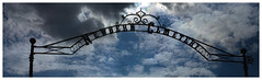 Newbern Cemetery (daveelmore) Tags: sky panorama cemetery sign virginia iron arch entrance manualfocus stitchedpanorama legacylens newbernva penfm43adapter hzuiko42mm112 newberncemetery