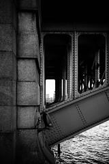 Through bridges (lorenzoviolone) Tags: bridge england blackandwhite bw london water monochrome thames river blackwhite riverside unitedkingdom streetphotography finepix fujifilm streetphoto through riverthames thameside agfascala200 mirrorless vsco streetphotobw vscofilm fujix100s x100s fujifilmx100s travel:uk=londonapr16