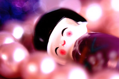 Bed of Pearls (denOhmarie) Tags: pink macro closeup digital canon doll purple violet ring sparkle pearl reverse kokeshi 600d