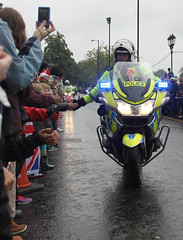 Hand to Hand (CWigs) Tags: bedford police motorbike torch olympic embankment london2012 olympictorchrelay