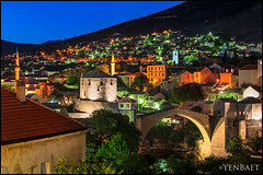 Mostar - Twilight at Stari Most and the City (Yen Baet) Tags: city travel bridge architecture river photography photo twilight ancient europe european cityscape mostar bosnia postcard unesco worldheritagesite restoration ottoman picturesque reconstruction starimost rehabilitation bosniaandherzegovina neretvariver bosniaihercegovina yenbaet croatbosniakwar