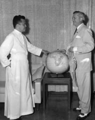 Governor Daniel and Monsignor Flores