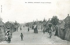 Village of N'Dengou, Rufisque (now a suburb of Dakar), Sénégal (West Africa), c. 1905 (gbaku) Tags: pictures africa old houses woman west history wall architecture work children town photo construction women village child photos native african femme picture villages case architectural historic huts photographs photograph westafrica afrika historical senegal dakar walls anthropologie shelter artifact towns artifacts anthropology femmes cases artefact shelters africain ethnography dwellings geschichte ethnology sénégal artefacts africaine westafrican ethnologie rufisque afrikas ndengou