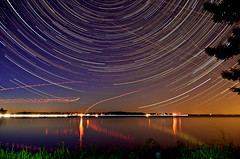 Star Trails - St. Francis Island #1 (lynn.h.armstrong) Tags: camera trees ontario canada green art cars water grass st night reflections river lens stars geotagged boats francis island photography star golden photo lawrence interesting mac aperture nikon long flickr zoom south north trails images lynn h planes land getty nikkor armstrong stormont vr licence afs request startrails dx sault attribution ingleside ifed 18200mm f3556 noderivs vrii summerstown d7000 lynnharmstrong