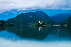 Bled - The Pilgrimage Church of the Assumption (Yen Baet) Tags: city trip travel vacation mountain reflection church nature water architecture landscape boats religious photography town photo twilight ancient europe european waterfront view dusk postcard hill religion scenic eu landmark icon tourists slovenia alpine vista bled bluehour picturesque iconic waterscape glacial julianalps bledcastle blejskigrad churchoftheassumption veldes stmartinsparishchurch pletnaboats uppercarniola yenbaet assumptionofmarypilgrimagechurch burgveldes