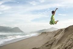 Leap (Gabe Ghost) Tags: brazil sky praia beach brasil jump sand florianópolis wave salto menina leap gabrieltvs gabeghost thaissouza
