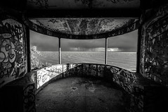 Storm Shelter [Explored] (Scott Baldock Photography) Tags: light sea england urban blackandwhite bw storm building abandoned beach monument look rain thames clouds out landscape graffiti mono bay pier seaside nikon mod air exploring ministry great estuary east pigs raid shelter bomb leigh derelict essex leighonsea southend shoeburyness defence garrison lightroom westcliff urbex southendonsea southchurch chalkwell shoebury blackwhitephotos wakering prittlewell d5000 bestevercompetitiongroup