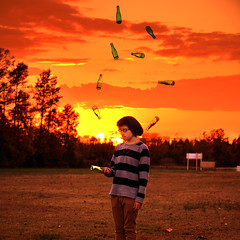 43/365 Juggling Act (Bryan_Chavez) Tags: light sunset red orange sunlight yellow square photography golden bottles magic manipulation bryan hour format juggling act chavez