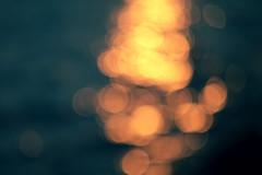 Golden sunlights on blue water background. (ManhDesign.Inc) Tags: christmas travel blue light sea summer vacation sky orange sun sunlight white abstract color texture nature water beautiful beauty glitter season lights golden shiny pattern shine bright bokeh background seasonal decoration blurred sparkle gleam glowing blink textured defocused luminosity