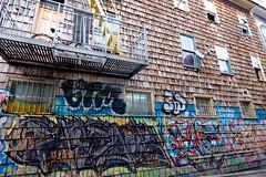 Little Journey (Sean Davis) Tags: sanfrancisco art bicycle wall graffiti mural fireescape satellitedish directv