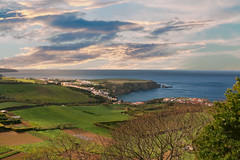 Overlooking Atlantic Ocena (free3yourmind) Tags: ocean houses sea green portugal clouds day village view cloudy panoramic atlantic fields cape overlooking azores saomiguel