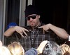 Donnie Wahlberg of New Kids On The Block greets fans as he leaves a hotel in Dublin Dublin, Ireland
