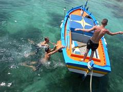 the wind rose (estella7272) Tags: sea boat mediterraneo barca mare sicily acqua molo sicilia mondello pontile ragazzi rosadeiventi thewindrose primenuotate larisalitaprimadeltuffo