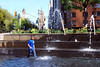 Enjoying a Dip (Rachel Citron) Tags: park nyc newyorkcity nikon streetphotography upperwestside nytimes gothamist waterfountain columbuscircle curbed hotday summerinthecity divingin thenytimes publicplay kidwithmohawk thelocaleastvillage uwskids