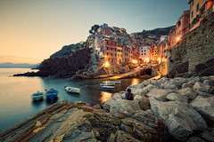 Sundown Showdown in Riomaggiore (Allard One) Tags: longexposure nightphotography sunset italy water vintage boats coast spring nikon rocks village nightshot sundown liguria scenic panoramic cliffs retro le vista coastline cinqueterre geography mei fishingboats commune lente region spectator eclectic italie showdown harsh mediterraneansea bold riomaggiore gettyimages vessels 2012 extremewideangle laspezia yellowed 14mm pittoresque famousplace locallandmark 100faves nationallandmark internationallandmark 200faves touristdestination nikcolorefexpro pictoresque 300faves towerhouses d700 coastalvillage nikond700 gulfofgenoa nikkor1424mmf28 mediterraneancountry nikonfx allardone allard1 duohardstrak rimazuu totallyradactionmixii fullframepower allardschagercom