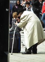 Self Portrait? (kenjonbro) Tags: camera old uk england selfportrait man london westminster macintosh photographer trolley trafalgarsquare disabled suitcase mack charingcross gentleman crutch sw1 dunlop kenjonbro fujihs10 worldpride2012