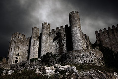 Dark Castle (Traveloddity) Tags: old light sky cloud holiday storm black building tower castle halloween portugal monument nature rain weather silhouette wall night clouds dark scary ancient shadows power view darkness fort outdoor background fear hill gray perspective ruin bad scenic royal ground medieval historic haunted creepy spooky horror terror intriguing moonlight disturbing obidos middleages ghosted