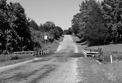 Old Mill Creek Road and Abandoned Railroad Right-of-Way, Brenham, Texas  1207211641BW (Patrick Feller) Tags: road old railroad bridge mill abandoned creek train way texas railway row grade disused brenham rightofway southernpacific giddings washingtoncounty rightof houstontexascentral pontist