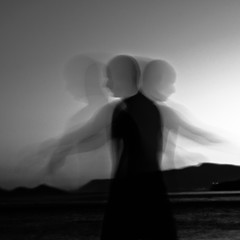 a sufi's shadows (Vasilis Amir) Tags: longexposure sunset sea portrait blackandwhite motion male water monochrome silhouette sunrise square moving experimental ghost move transparency transparent reflexions slowspeed ixtlan  abstractportrait  mygearandmesilver vasilisamir