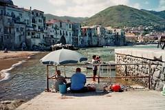 (Monica Forss) Tags: sea italy film beach analog 35mm italia fishermen sicily analogue sicilia cefal fujisuperiaiso200 minoltaprod20s