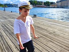 Captain At Work (Steve Lundqvist) Tags: boy sea summer hat kid sweden stockholm cap sailor 2012 me2youphotog