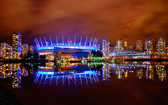 Vancouver BC Place in Blue at Night (TOTORORO.RORO) Tags: city longexposure travel autumn light canada reflection tourism sports water colors skyline night vancouver buildings lens landscape living landscapes downtown cityscape bc view zoom stadium britishcolumbia sony performance seawall arena condo falsecreek alpha venue hdr condominiums nationalgeographic retractable bcplace oss nex greatervancouver mirrorless powerzoom 1650mm nex6 selp1650