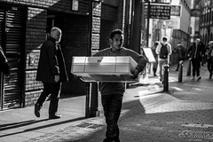 What's In The Crate? (Silver Machine) Tags: street bw man london monochrome walking mono blackwhite chinatown looking candid streetphotography streetportrait crate canoneos canon600d canonef50mmf18stm
