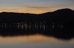 Lights In The Night (Beads N Resin) Tags: city longexposure sunset orange mountain lake reflection water silhouette lights berkeley rainbow australia calm nsw serene lighttrails bluehour romina lakeillawarra traillights primbee romina01 rom01