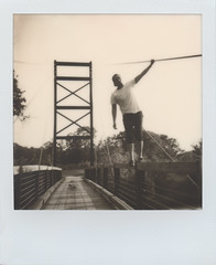 Suspend (benjaflynn) Tags: bridge portrait people blackandwhite bw hot male guy geometric monochrome metal rural polaroid outside outdoors person climb countryside daylight illinois spring friend warm industrial masculine path warmth sunny carlos faded cables edge portraiture leisure daytime grayscale railing youngadult suspensionbridge instantcamera pola earlysummer expiredfilm roid thequarry plasticlens whiteborder suspend fixedfocus instantfilm 600film thecountry scannedfilm primelens iso640 insta polalove rurality jobpro2 bigrockforestpreserve integralfilm epsonperfectionv500 bigrockquarry theimpossibleproject polaroidjobproii benseidelman impossiblefilm polaroid116mmlens impossibleblackwhite20 bw20edition expired316