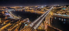 Porto and the stars (Pietro Faccioli) Tags: city bridge roof winter light sky reflection portugal water lamp skyline night river stars lights evening town traditional horizon estuary roofs warehouse lamppost porto douro riverfront gaia ribeira pietro faccioli pietrofaccioli