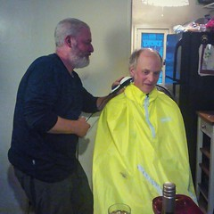 Last night's party at #thechapelonthehill turned into a haircut party. Here, Brad gives Traveling Dan a summer trim. And who knew that a rain cape makes such an effective bib?  #carradicebags #carradice #raincape (urbanadventureleaguepdx) Tags: carradice raincape carradicebags thechapelonthehill