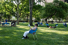 Battery Oval (Terese Loeb) Tags: park newyorkcity trees newyork dogs children manhattan shade tranquil lowermanhattan strollers womanreading batteryoval