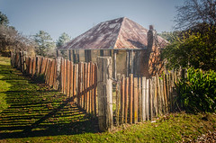 Of days gone by (DingoShoes - life's a dream) Tags: wood old shadow building architecture rural fence gold nikon timber country cottage australia historic wanderlust explore nsw nikkor derelict tinroof dilapidated rundown hillend goldminingtown afsnikkor18105mm13556ged nikond7000 beyerscottage
