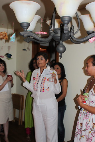 Host Yolanda Alvarado welcoming guests