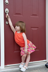 June 22, 2012_10 (Kim_Reimer) Tags: door pink red baby canada silly color cute girl childhood handle kid toddler child bc outdoor britishcolumbia daughter adorable posing skirt innocence tanktop northamerica carefree 2yearsold sleeveless gettyimagescanada