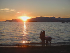 Last Moments on the Beach (DJ Greer) Tags: sunset sea people mountain reflection english beach water vancouver reflections island evening bay couple bc dusk bowen